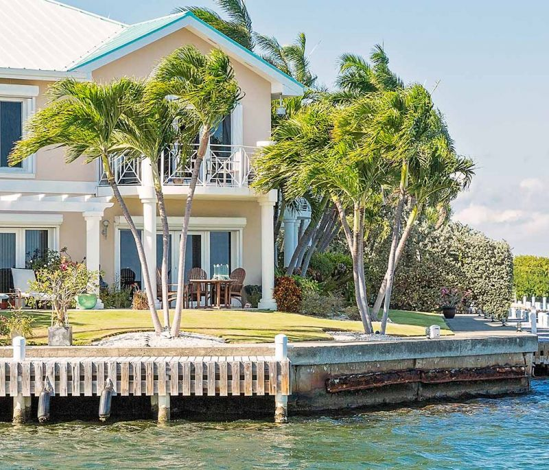A property right by the water with palm trees